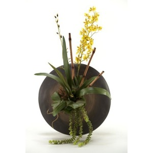 orchids w/foliage in wall sconce