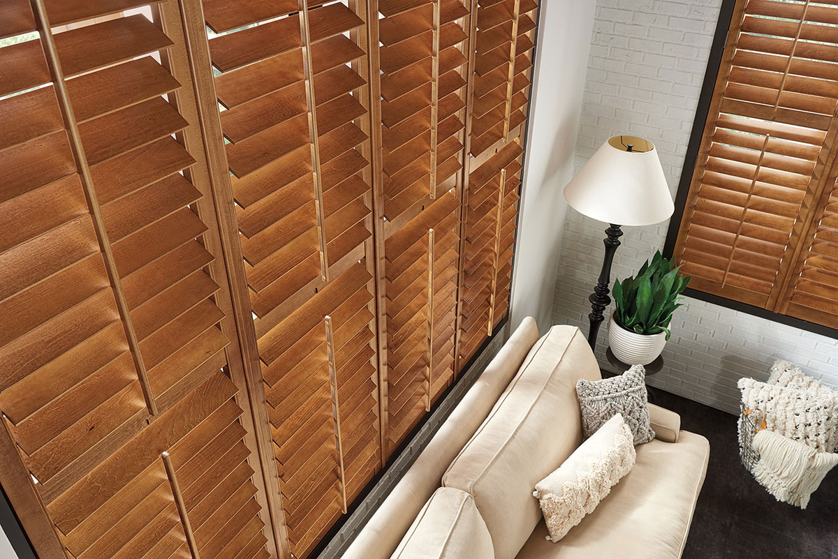 Bedroom featuring Graber Wood Shutters