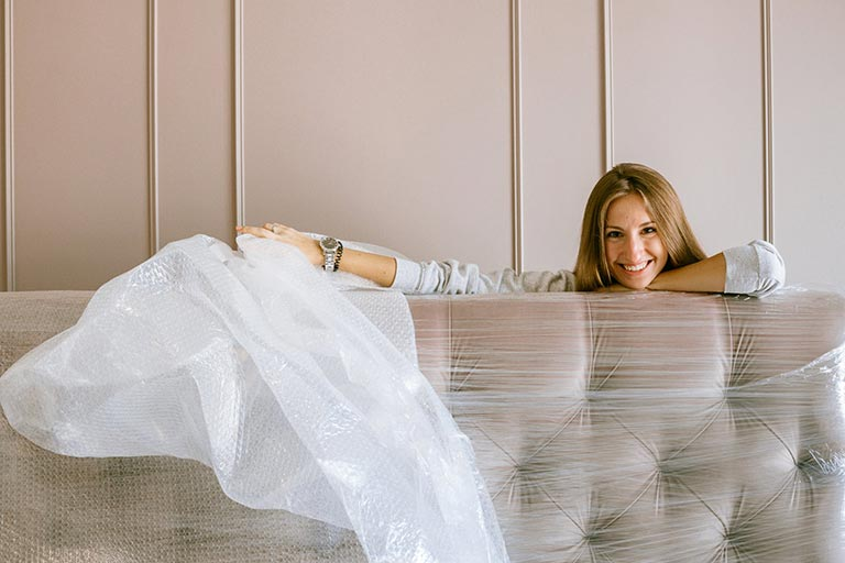 Person sitting on a bubble wrapped couch