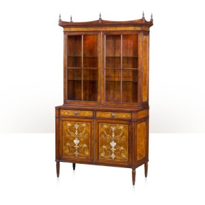 A laurel burl and mother of pearl inlaid library bookcase  Cabinetry