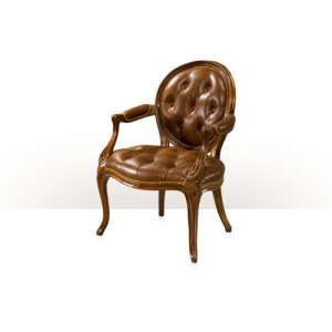 A hand carved mahogany armchair Seating