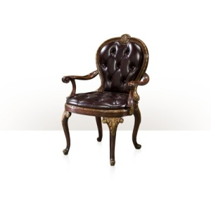A hand carved and gilded library armchair Seating