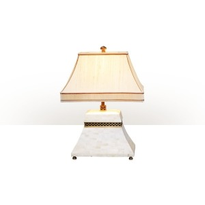 A bone and brass table lamp