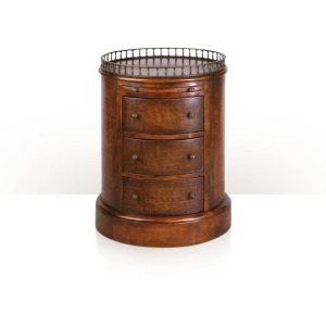 A brown leather panelled oval pedestal chest of drawers
