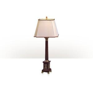 A carved mahogany table lamp