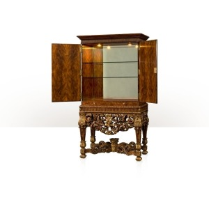 A flame mahogany cocktail cabinet on stand