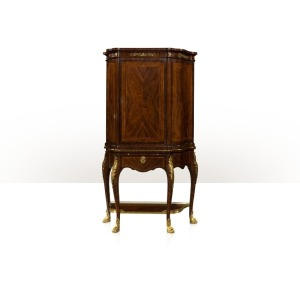 A rosewood and line strung cocktail cabinet