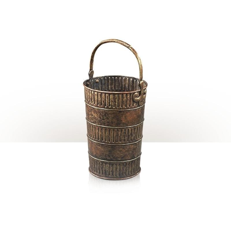 A patinated beaten brass bucket
